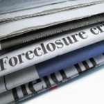 Newspaper with Foreclosure visible, Foreclosure crisis